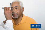 Photo of older adult African-American man getting his eyes checked by an eye care professional. Logo: NIH—National Institutes of Health. Logo: National Eye Health Education Program—NEHEP—A program of the National Institutes of Health.