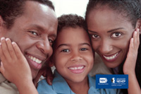 African American father, son, and mother smiling; the son has one hand on each parent's cheek. NIH, National Eye Intitute. NEHEP, National Eye Health Education Program, a program of the National Institutes of Health.