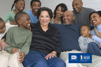 Three generations of an African American family sitting on a couch smiling. NIH, National Eye Institute. NEHEP, National Eye Health Education Program, a program of the National Institutes of Health.