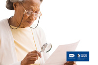 Older African American woman wearing glasses holding a magnifying glass reading a paper. NIH,  National Eye Institute. NEHEP, National Eye Health Education Program, a program of the National Institutes of Health.