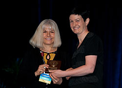 The 2010 Friedenwald Award is presented to Dr. Rachel R. Caspi by Dr. Justine Smith.
