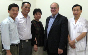Sieving with Dr. Chen Song (r) of Tianjin Eye Hospital and the patient's family
