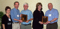 Dr. Maryann Redford, left, NEI project officer for the ETROP Study, joining Dr. William Good, principal investigator (PI) from the study headquarters in San Francisco, and Dr. Robert Hardy, far right, PI from the coordinating center in Houston, in presenting ETROP Inspiration Awards to Dr. Robert Gordon, PI in the New Orleans study center, and to Debbie Neff, New Orleans study center coordinator.