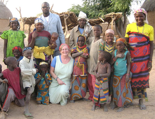 Dr. Sheila West (c) in Niger with children affected by trachoma.