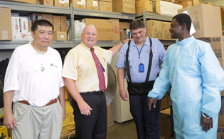 Wu, Weichbrod, White, and coworker Daniel Owusu at the loading dock.
