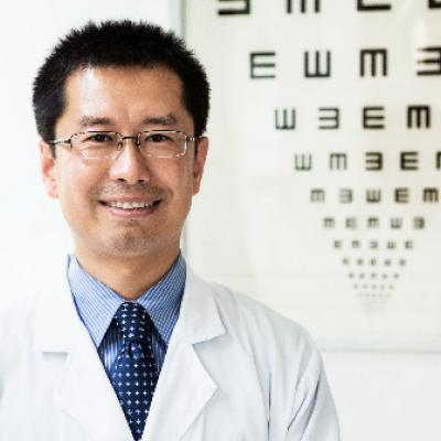 Eye doctor in front of eye chart