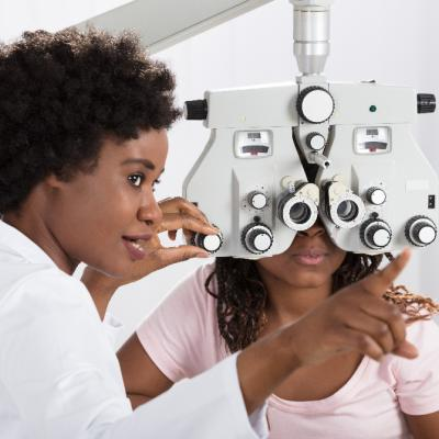 African American woman getting an eye exam