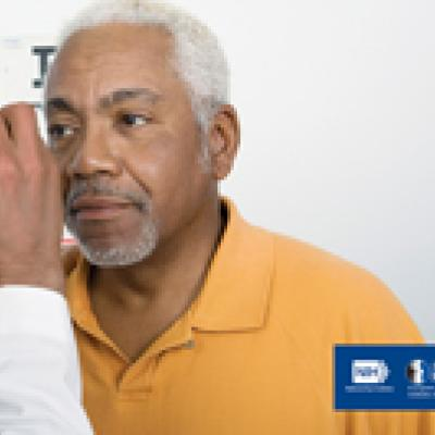 a male doctor examining a male patient's eye.  nih,  national eye institute. nehep, national eye health education program.