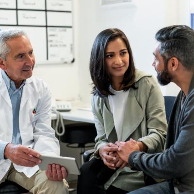 A doctor chatting with two patients