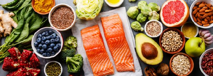 a variety of foods that are good for healthy vision like salmon and kale