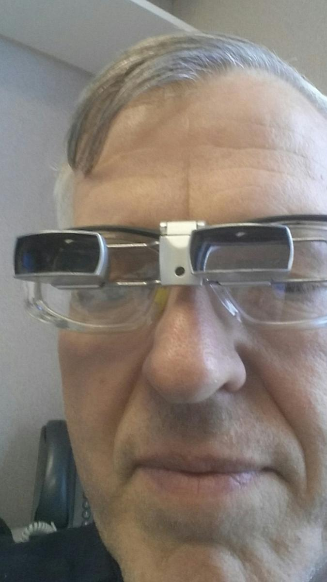 Man wearing prism glasses
