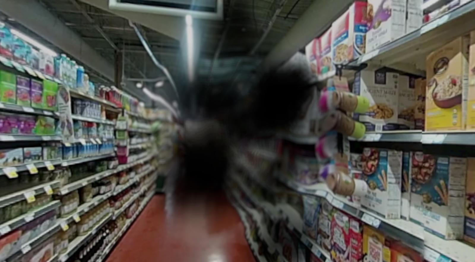 A simulation shows what the grocery store aisle looks like to someone with age-related macular degeneration. AMD damages the macula, a small spot near the center of the eye's light-sensing retina. The macula lets us see objects that are straight ahead — it's the part of the eye used for sharp, central vision.