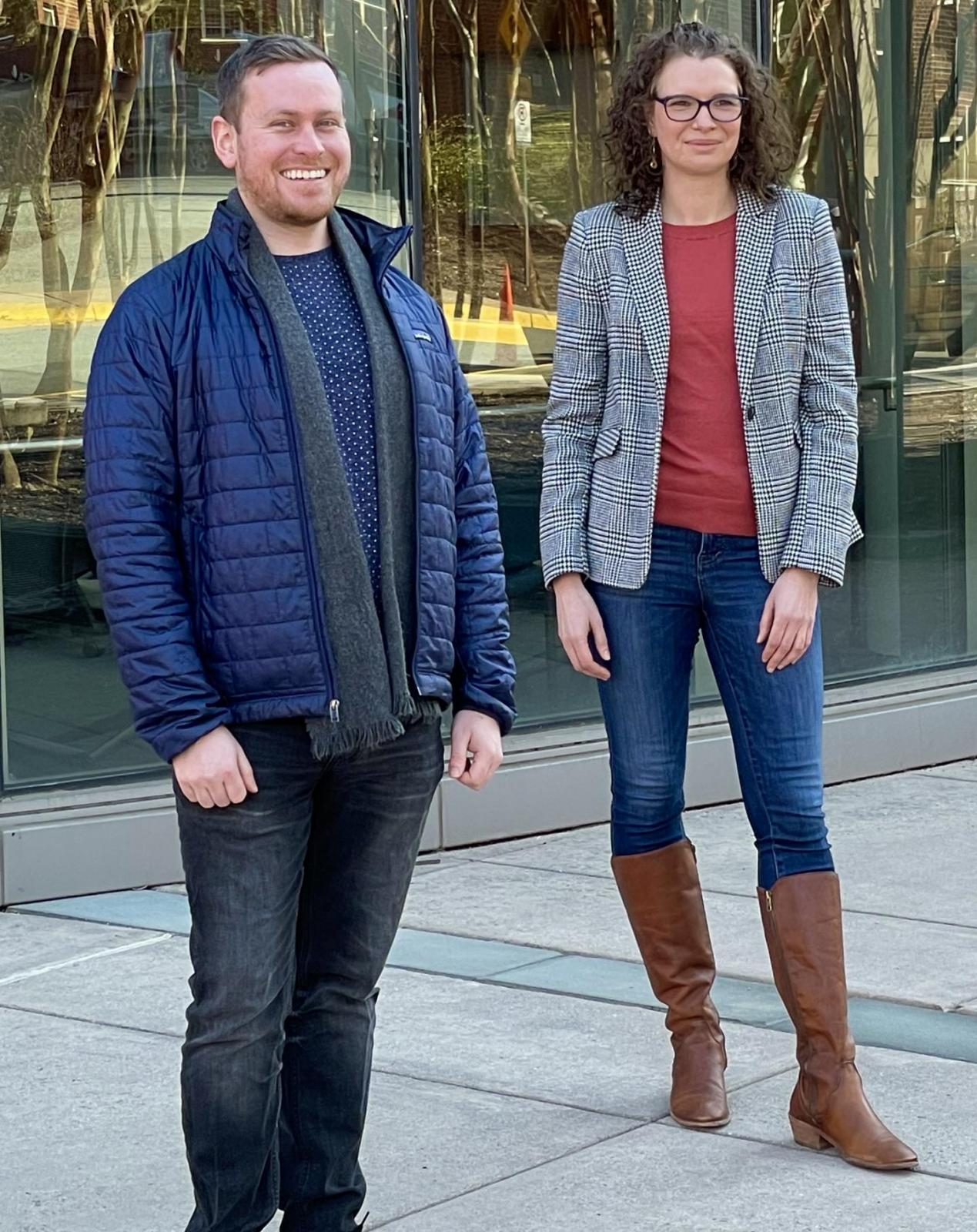 Two scientists standing on a sidewalk