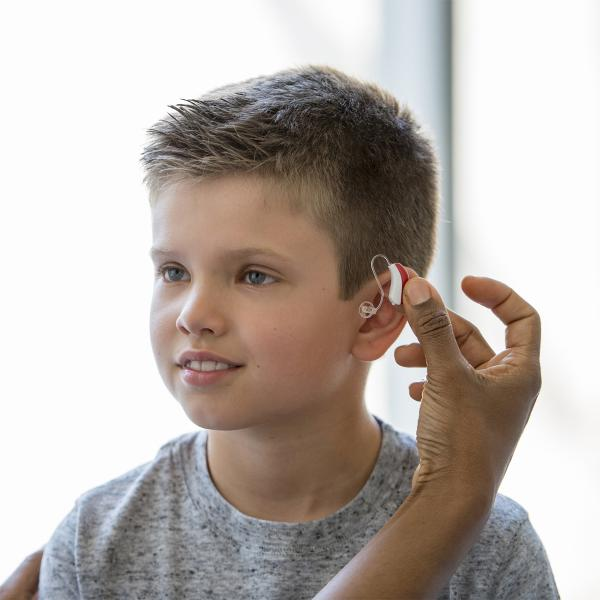 Young boy gets fitted for a hearing aid