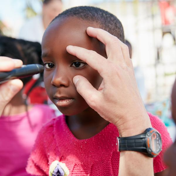 Young boy getting an eye exam
