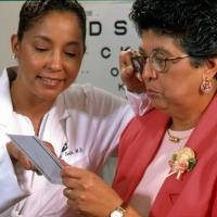 Woman taking visual acuity test