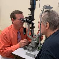 Patients in the trial were closely monitored for changes in vision, said Carl W. Baker, M.D. (left). During the 2-year study, the detection of 2 lines of visual acuity loss at one visit or 1 line of visual acuity loss at two consecutive visits prompted aflibercept injections to be given to the people in the laser or observation groups. Photo credit: Brooksie Beard