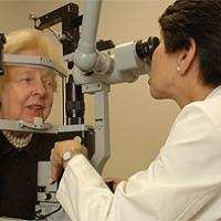 Dr. Emily Chew of the National Eye Institute examines a patient's eyes. Photo credit: National Eye Institute.