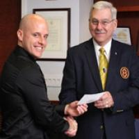 "James W. Gollady, Jr., Right Eminent Department Commander (right), presents Hotaling with a check from the Knights Templar Eye Foundation. ""I think this award is extremely important to pave a pathway for me in medical research,"" said Hotaling.  (Joe Balintfy, NEI)"